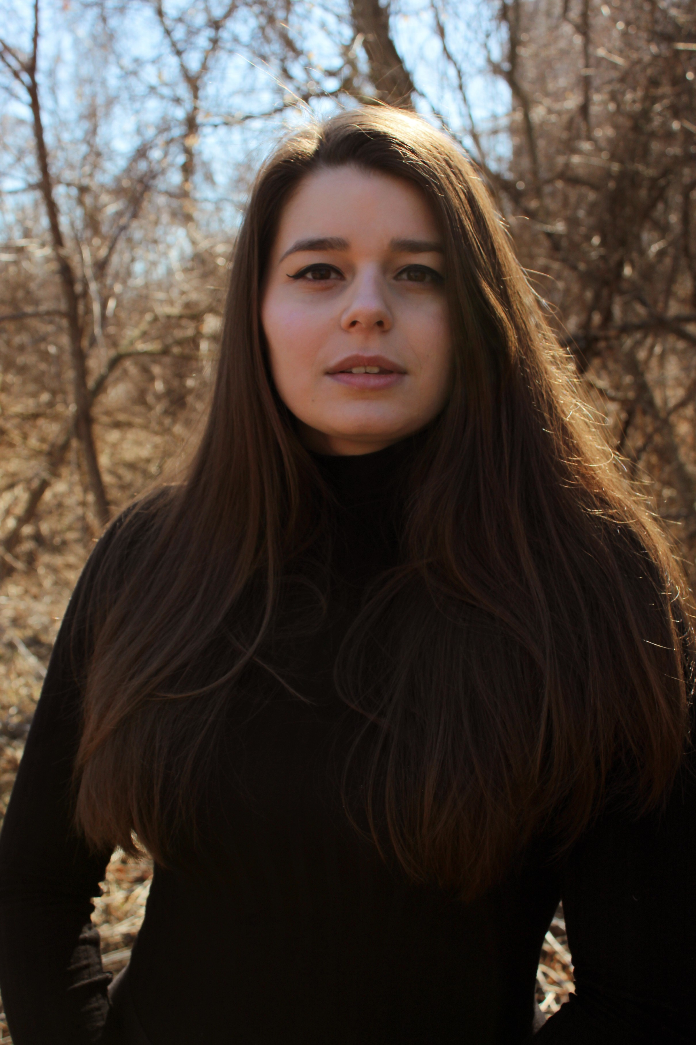 Photo of FMTV Graduate Breanna Purdy, standing in the woods.
