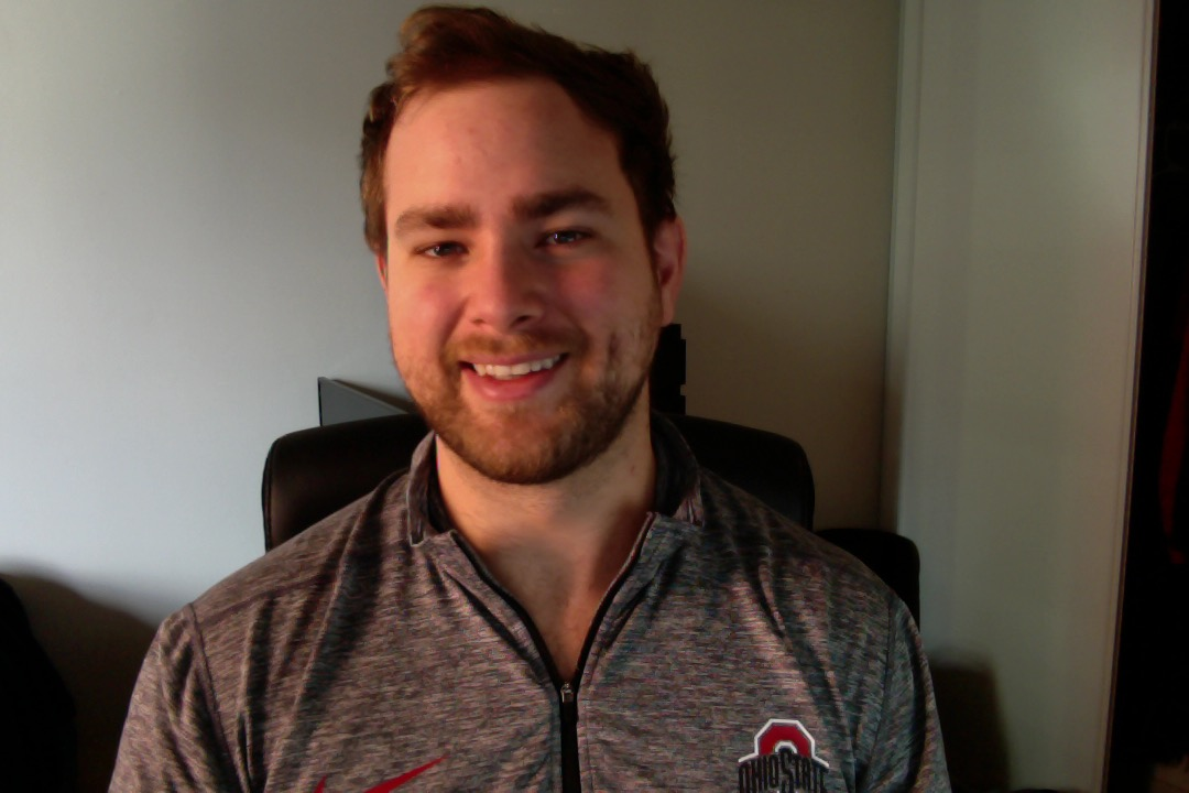 Picture of a man wearing a shirt from the sports team The Ohio State Buckeyes.