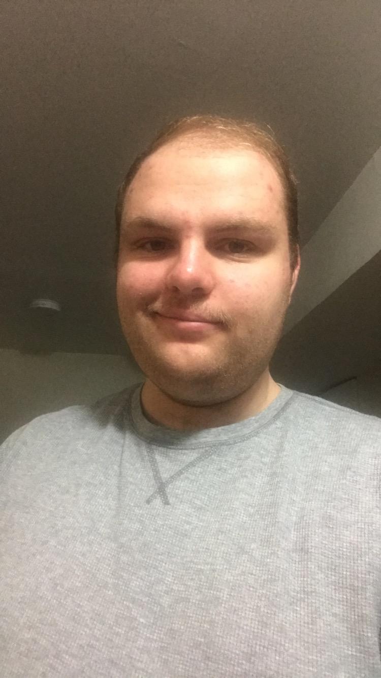 Man in white shirt smiling