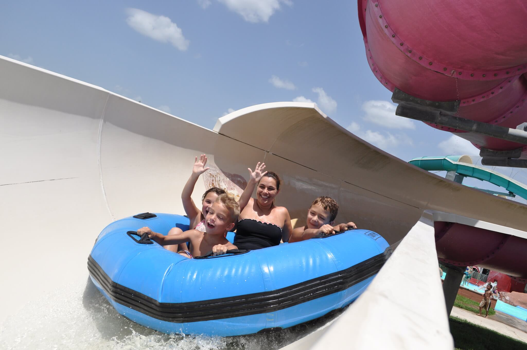 group of people in a tube going down a slide