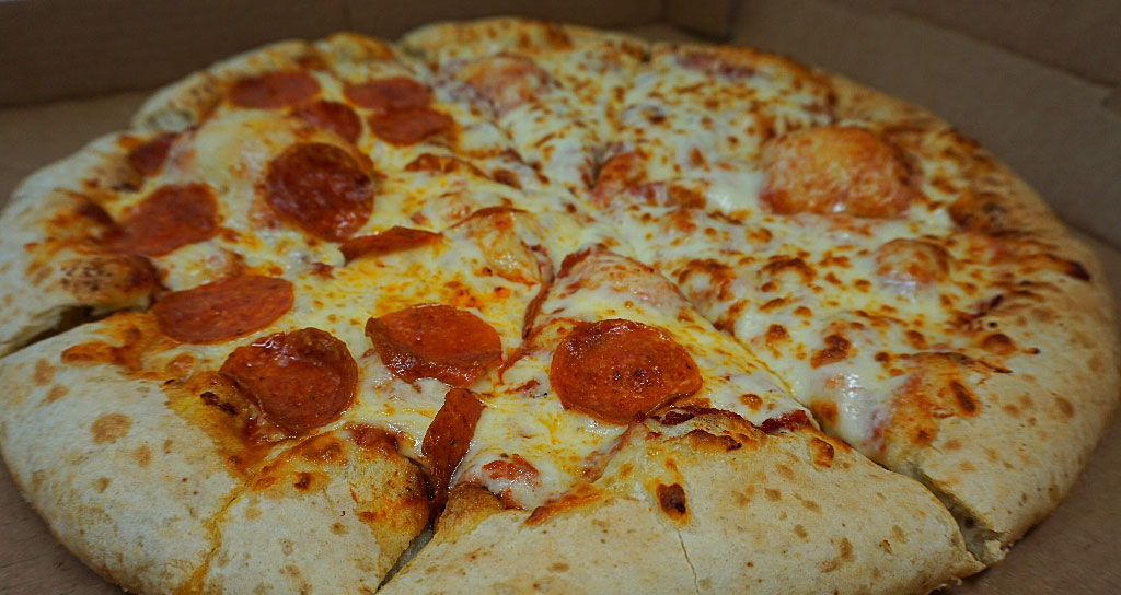 half pepperoni and half cheese pizza