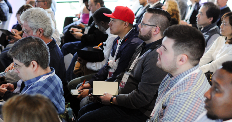 CV Conference attendees listen intently during a mainstage presentation.