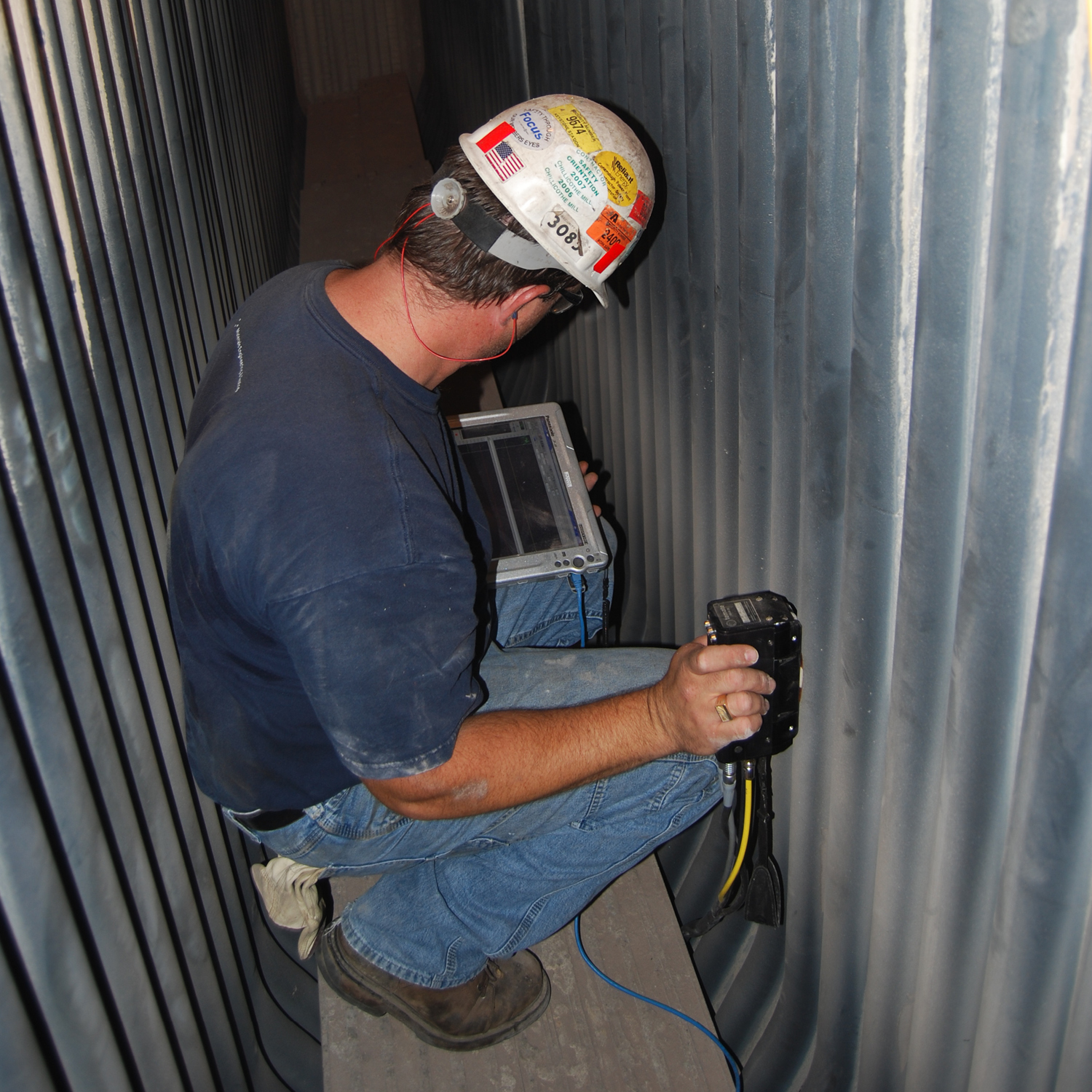 Inspector performing boiler inspection with the TG-IS (B) instrument