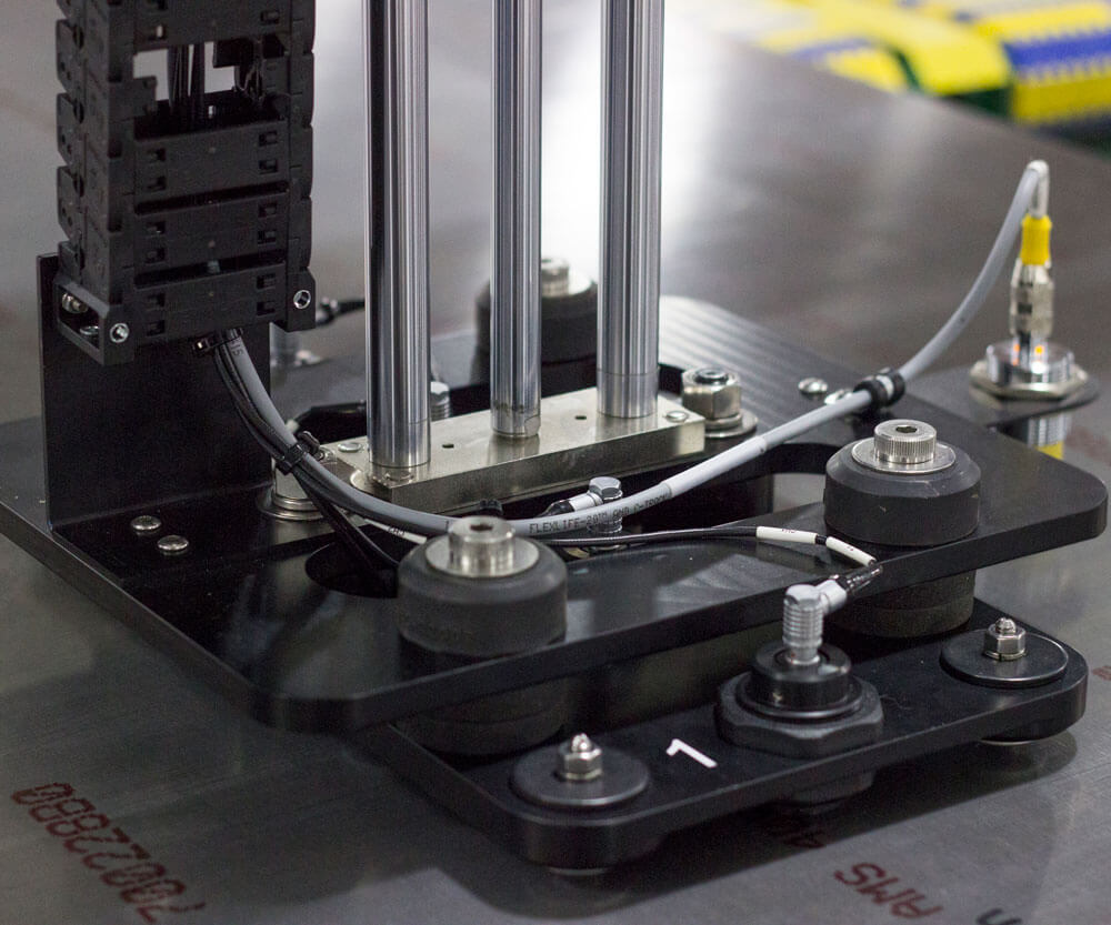 Automated instrument for electrical conductivity measurement on aluminum plates