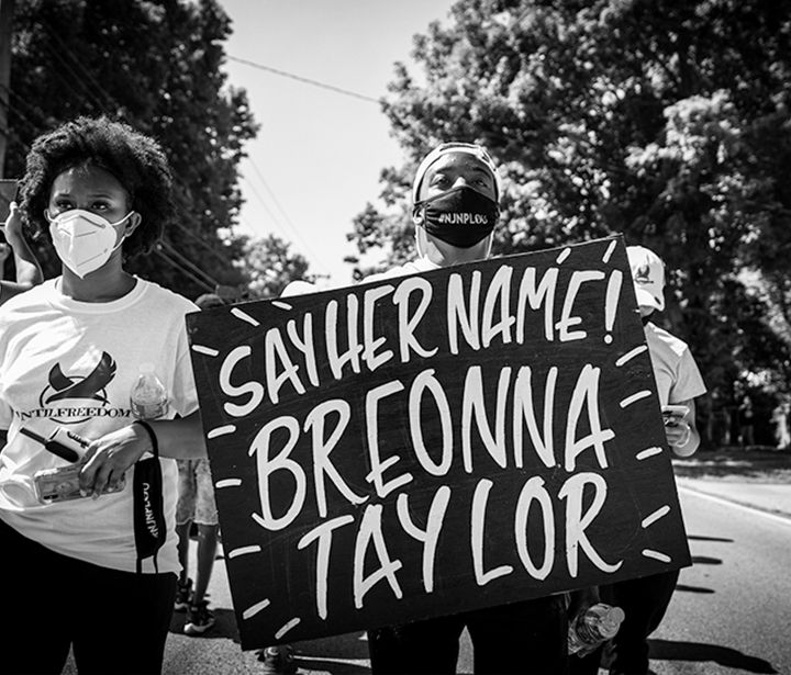 A group of people rallying to end police brutality