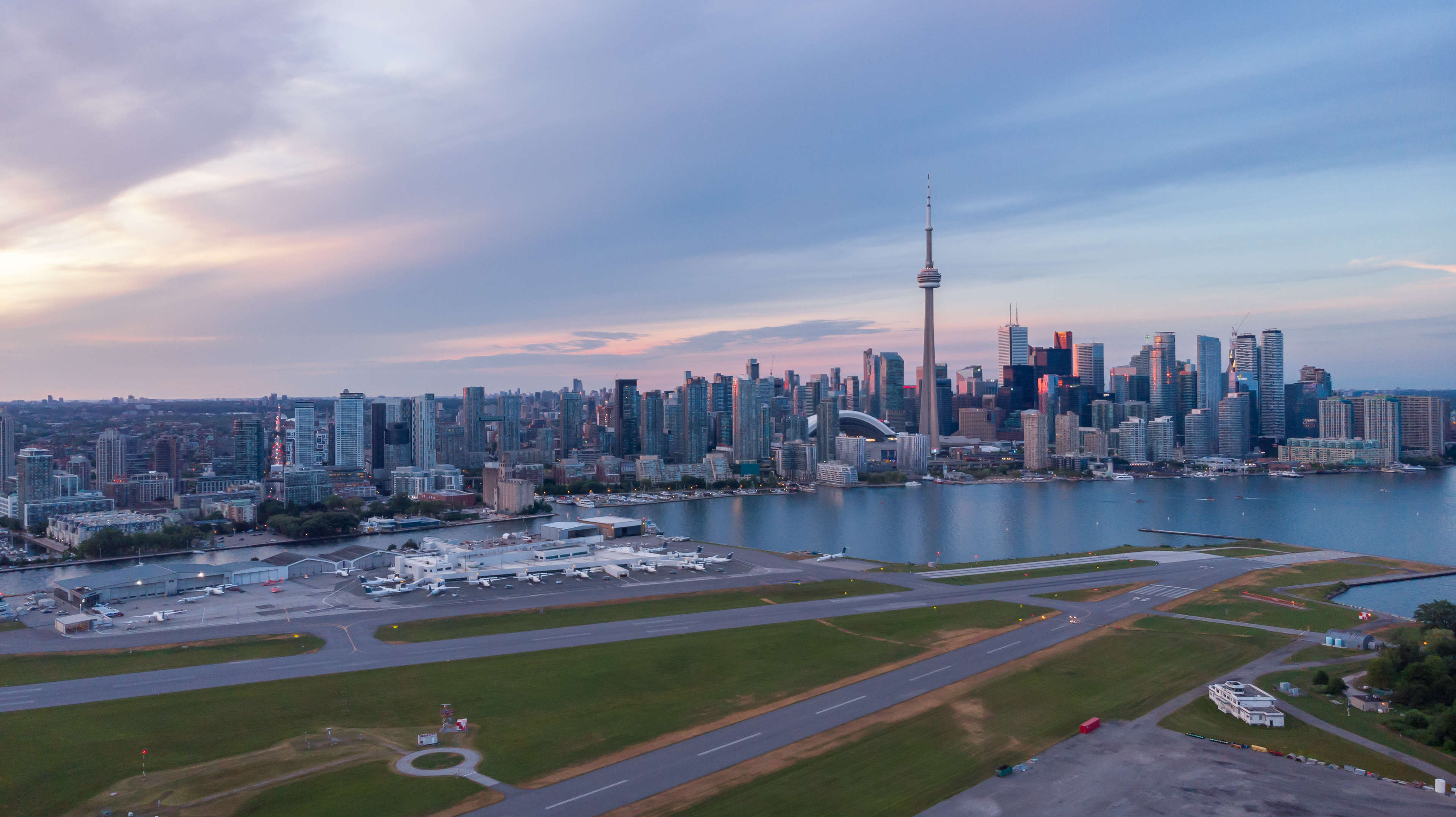 Billy Bishop Airport at dusk with the Toronto city sky line in the background.