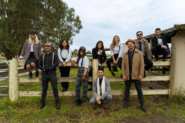 Milkman Agency team dressed as old fashion 1920s gangsters on a farm.