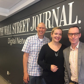 Andrew posing for a picture with staff at the Wall Street Journal offices.