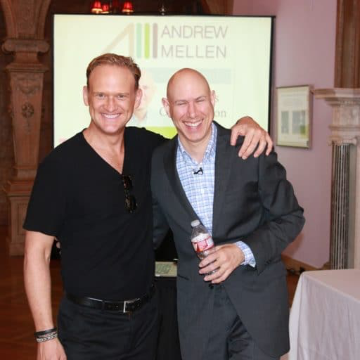 Andrew smiling for a photo after speaking at the 2014 EMC Master Class