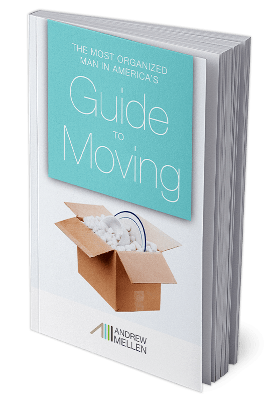 'The Most Organized Man in Americas Guide To Moving' paperback book displayed on a solid background.