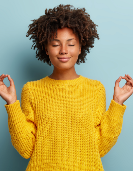 Satisfied woman makes okay gesture with both hands, relaxed with eyes closed, dressed in yellow clothes.
