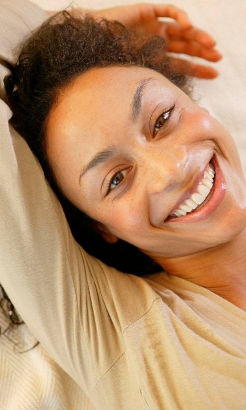 Relaxed, happy woman smiling at camera