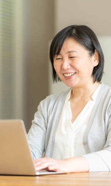 Asian woman enjoying online class from the comfort of her home.