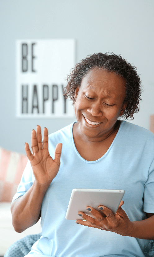 African-American woman with tablet computer at home