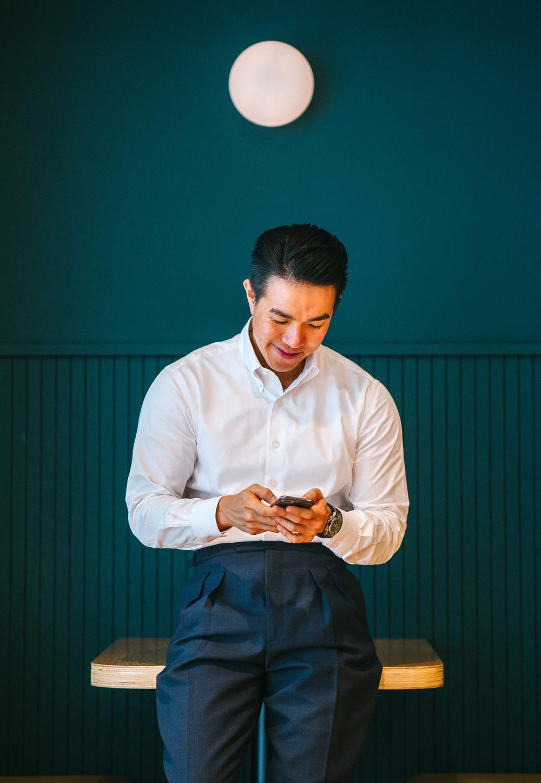 Man looking down at phone