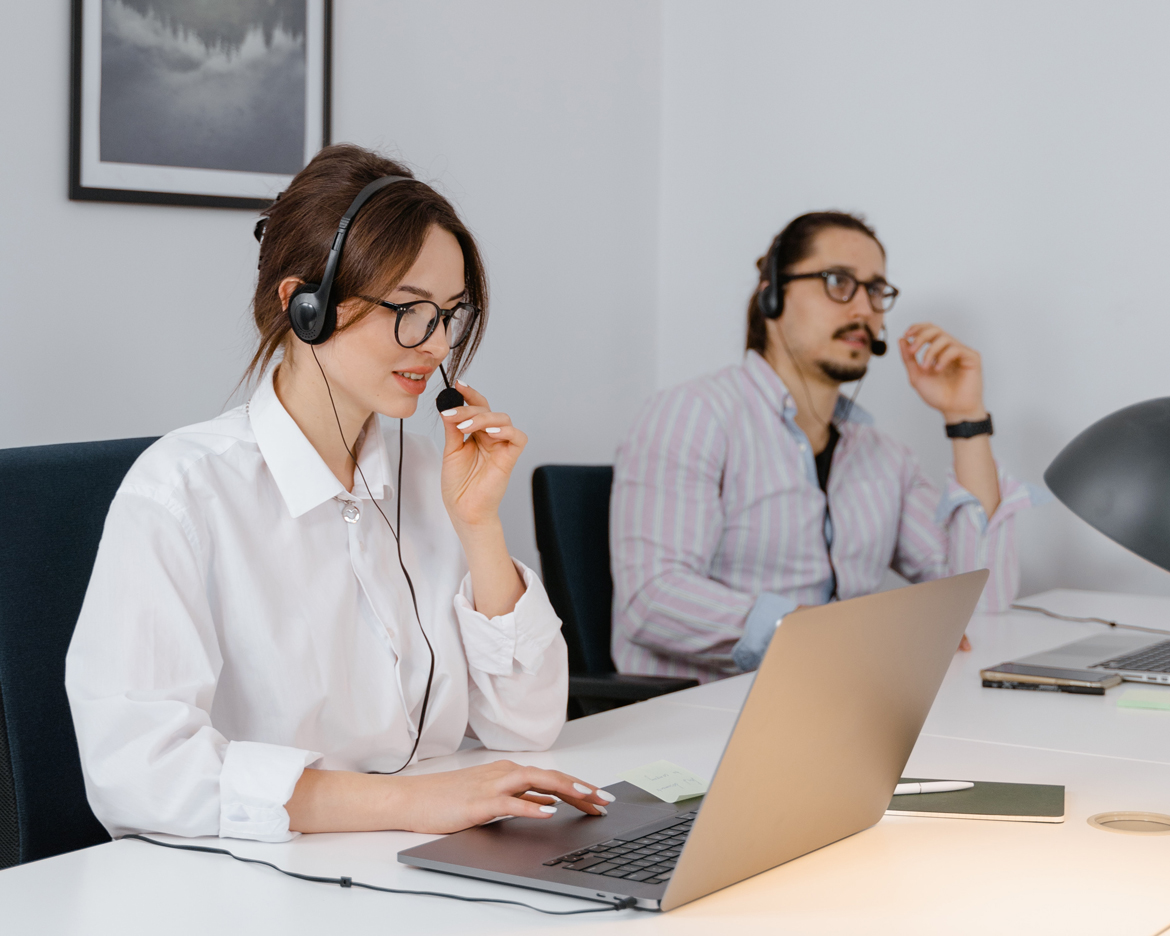 Two customer service agents sitting at a desk