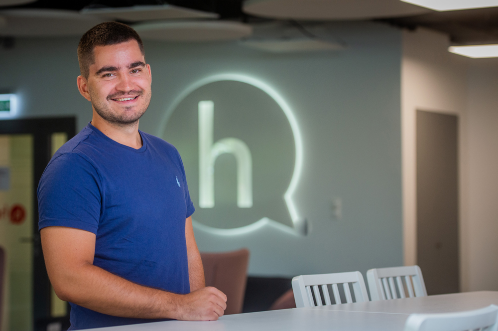 Hearsay employee standing and smiling