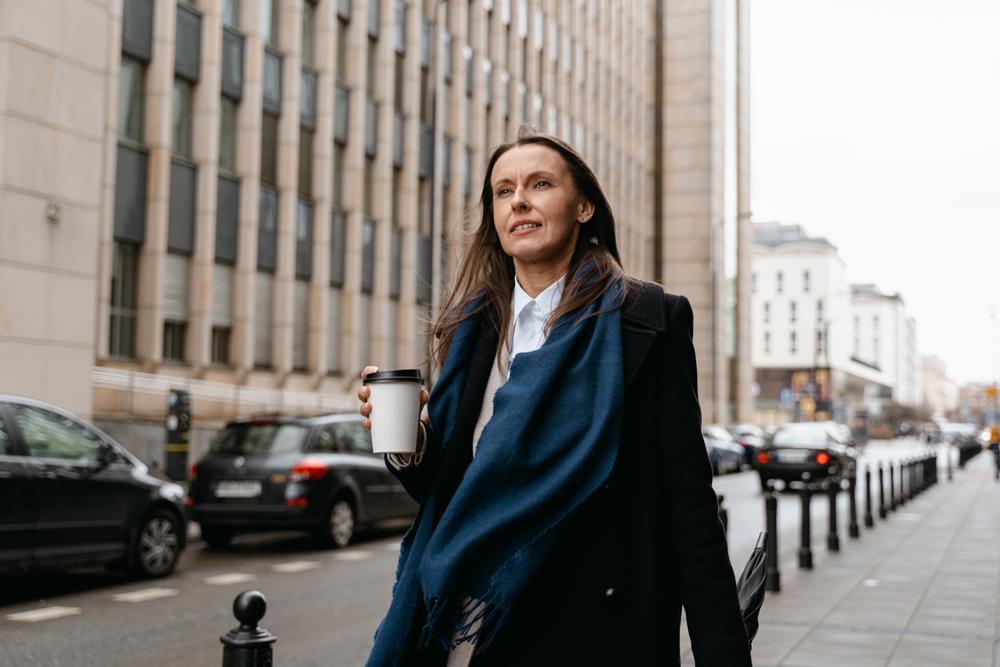 Woman in scarf walking outside