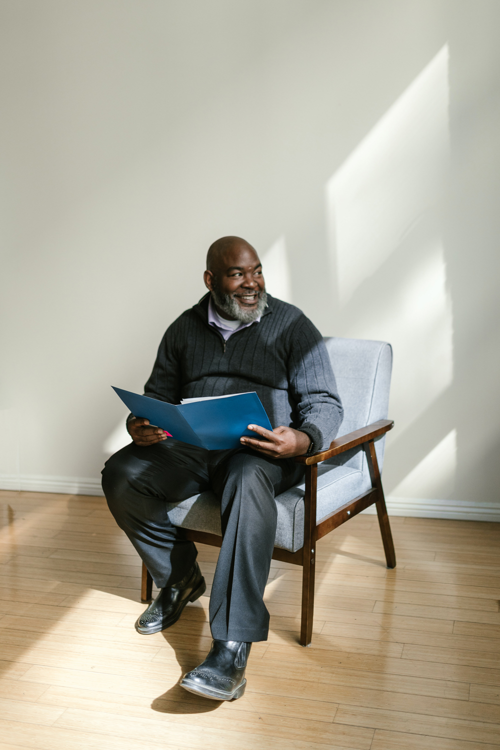 Man sitting in a chair for a photo