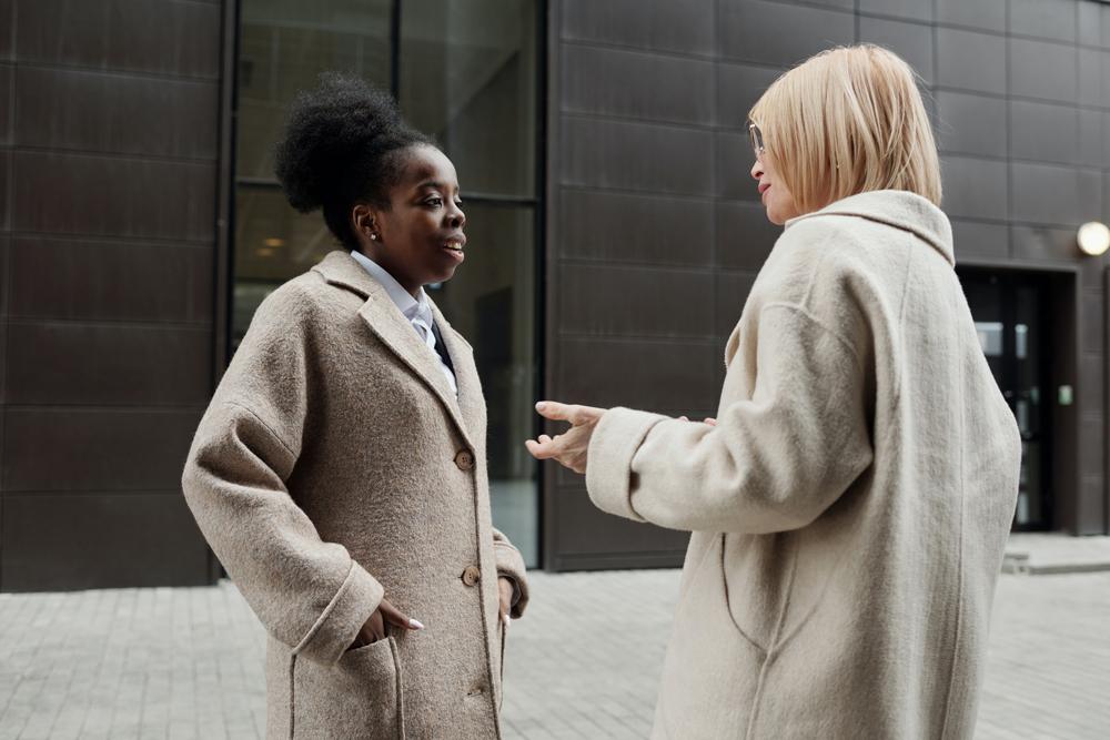Two business women talking outside
