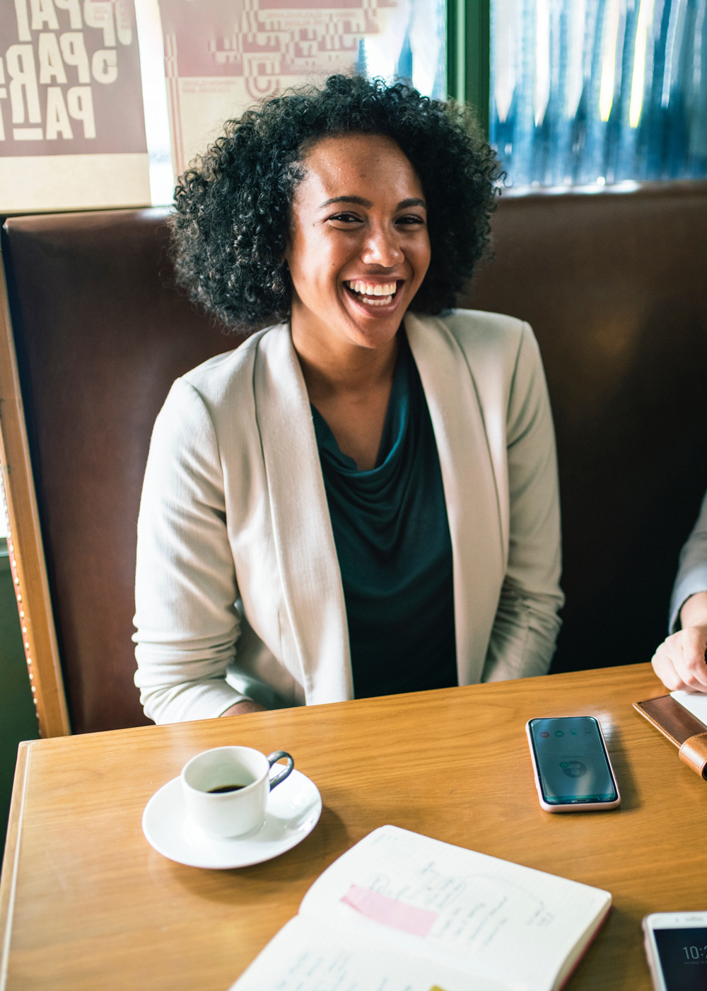Business woman sitting at table and smiling