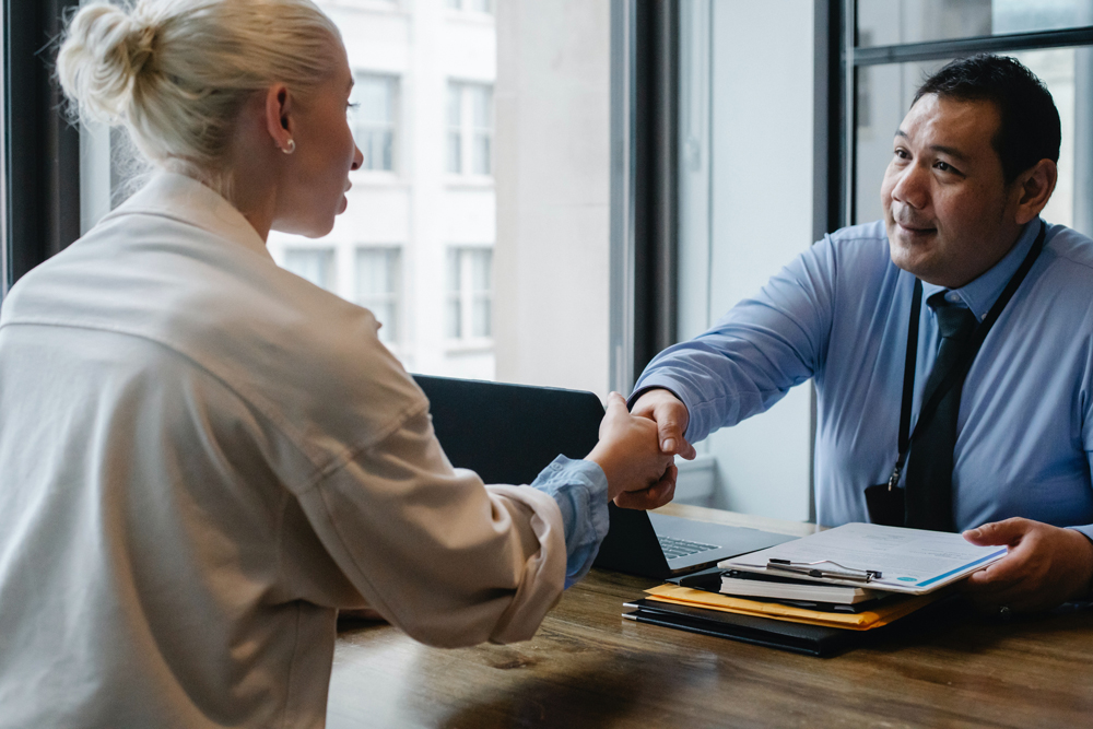 Business meeting with two people shaking hands