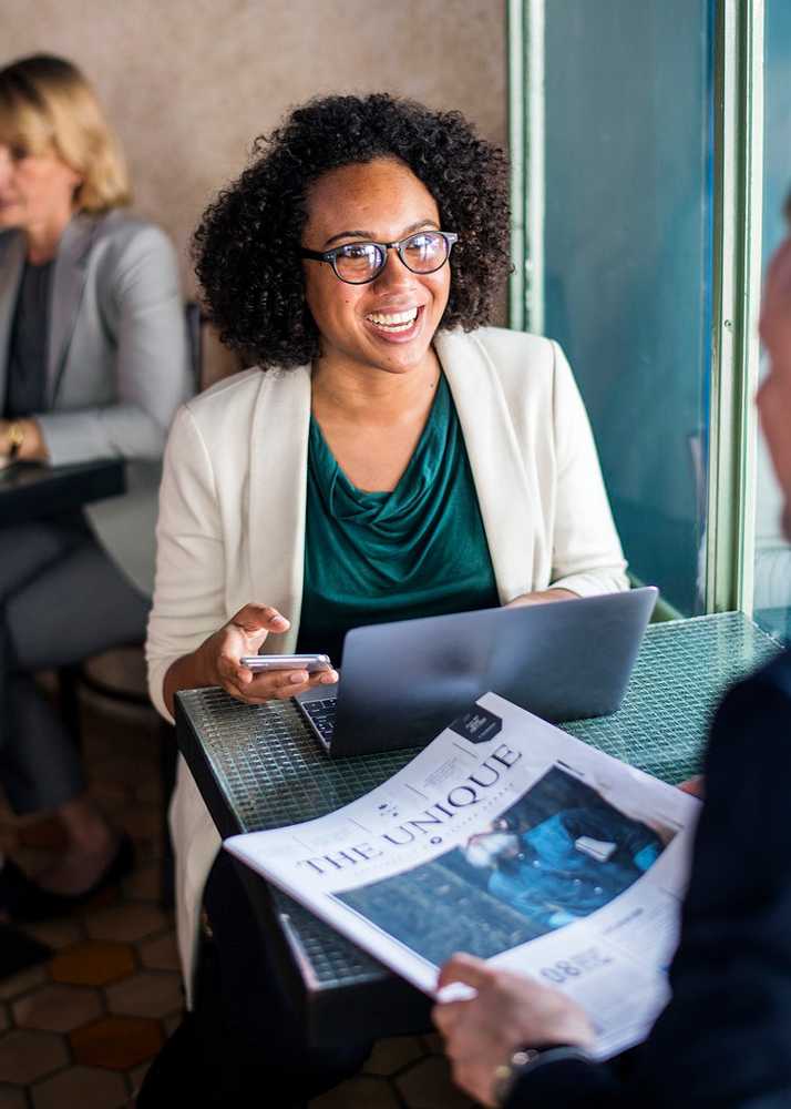 Business woman smiling on laptop