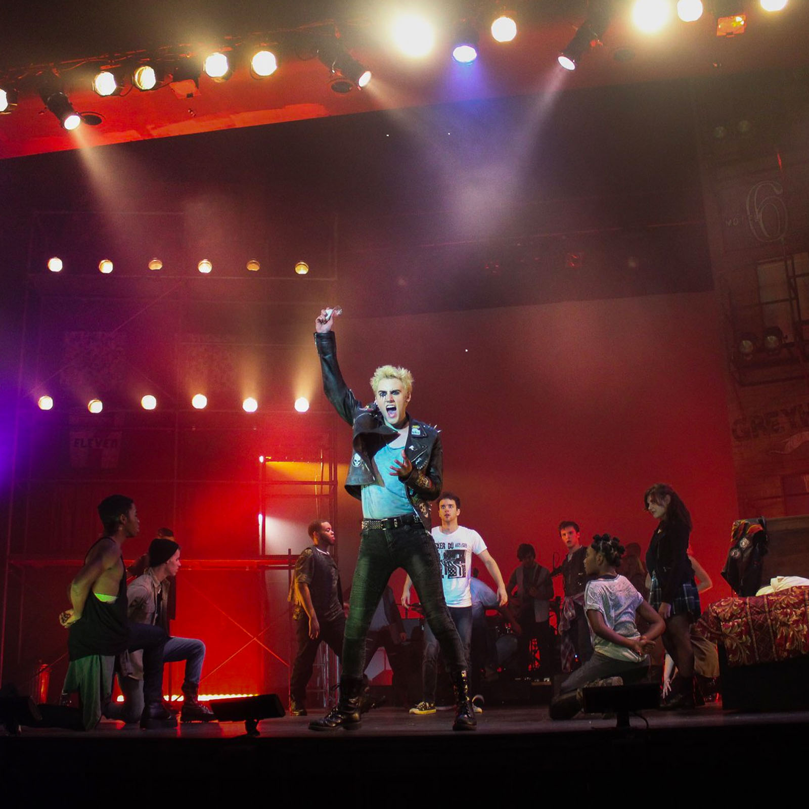 American Idiot- Man centerstage with fist raised