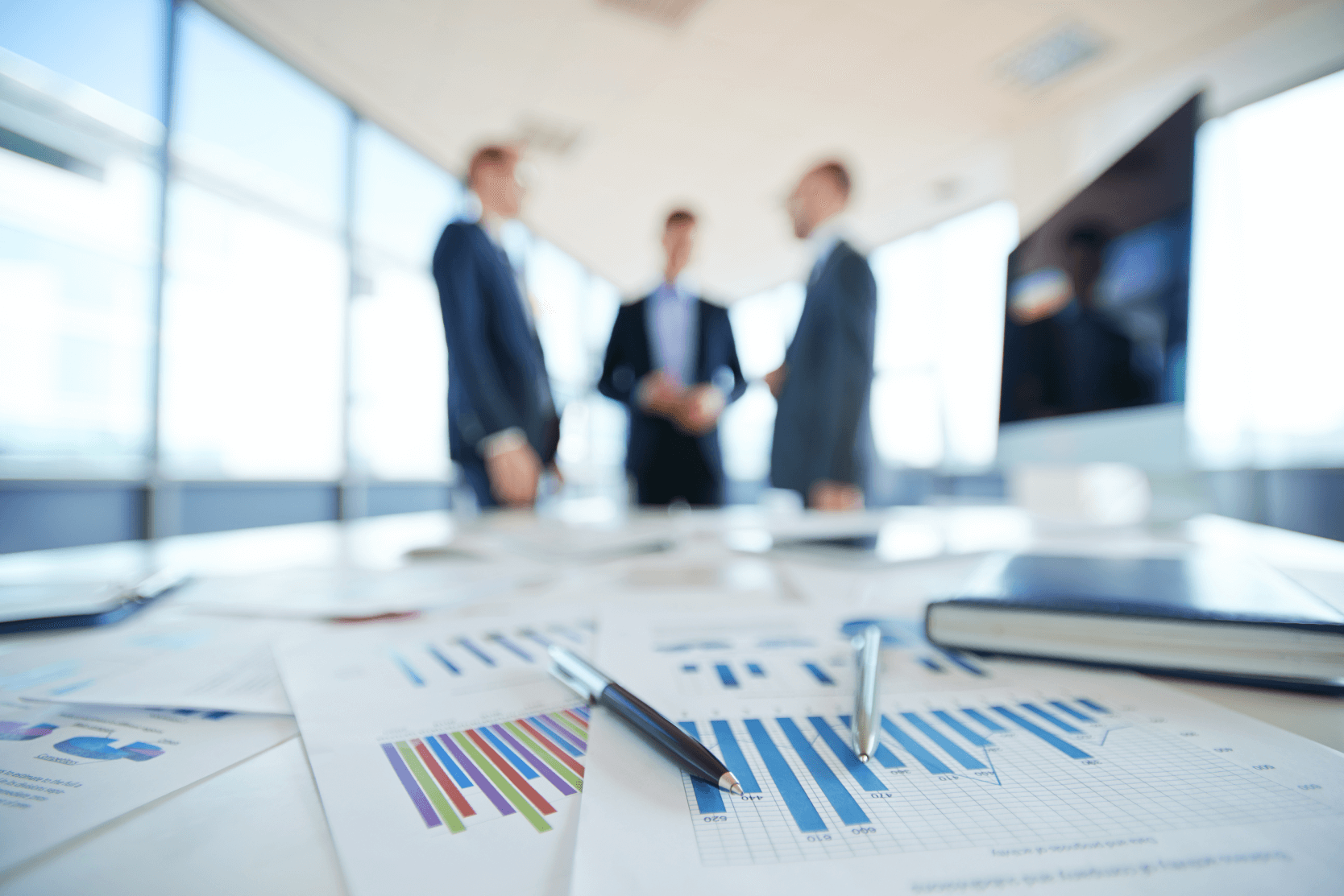Business Men around a table with financial papers