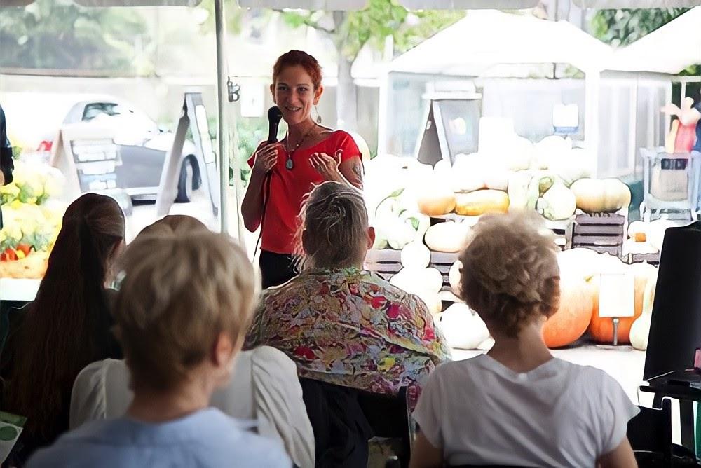 Mandi speaking to audience of people
