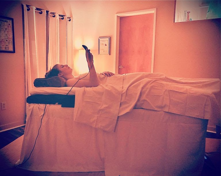 Woman lying on massage bed