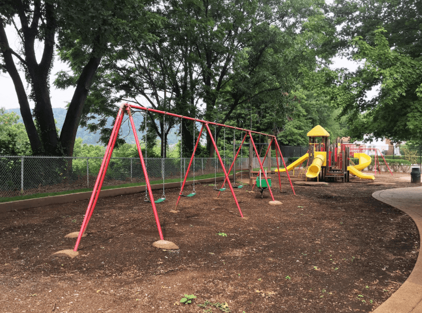 Swing sets and playground at park