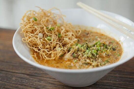 Crispy noodles inside of a rich, golden broth.