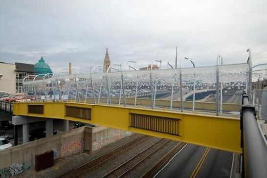 A yellow bridge with clear. decorative arches.