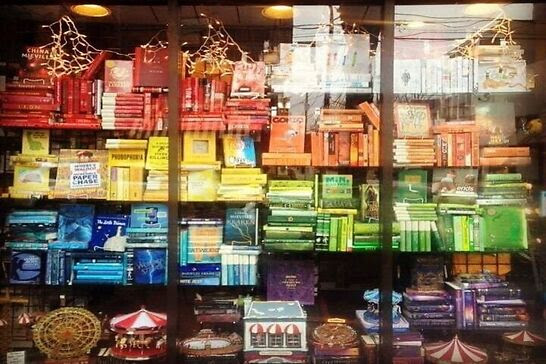 A colorful window display of books.