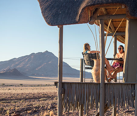 Tourists relaxing at Wolwedans Lodge in NamibRand Nature Reserve, Namibia