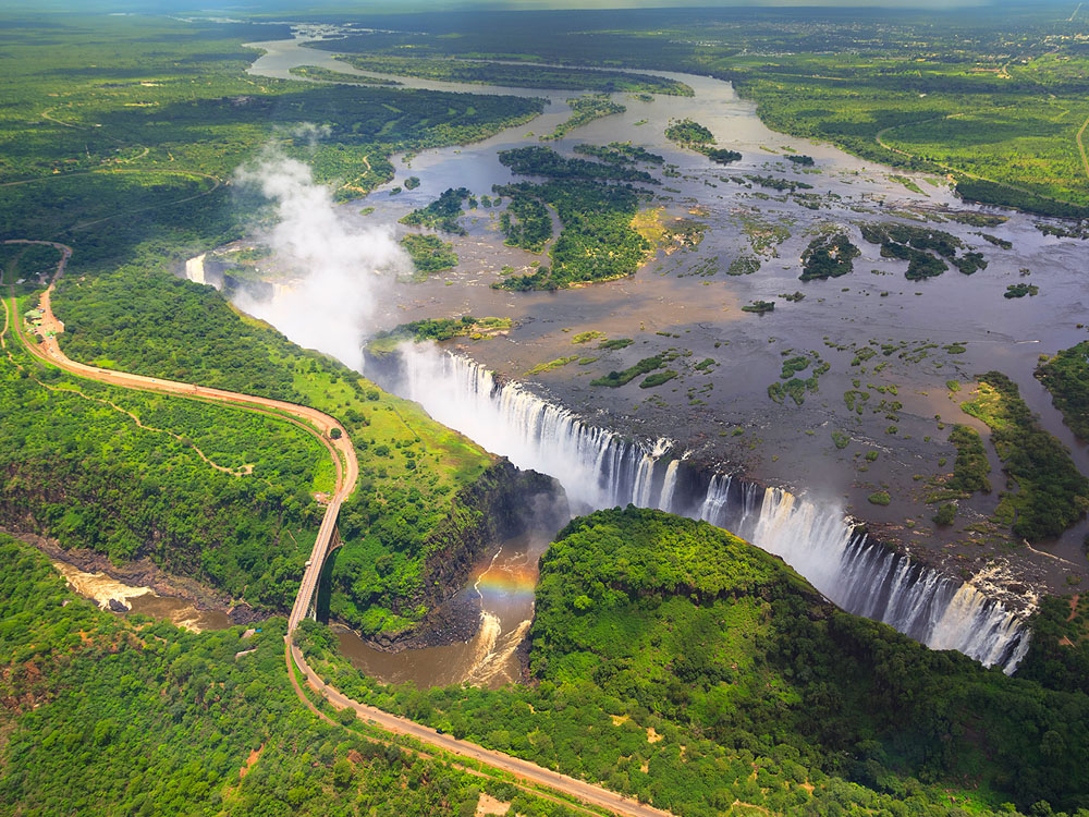 An aerial view over the Zambezi River, Victoria Falls, the gorge and the famous bridge between Zimbabwe and Zambia.
