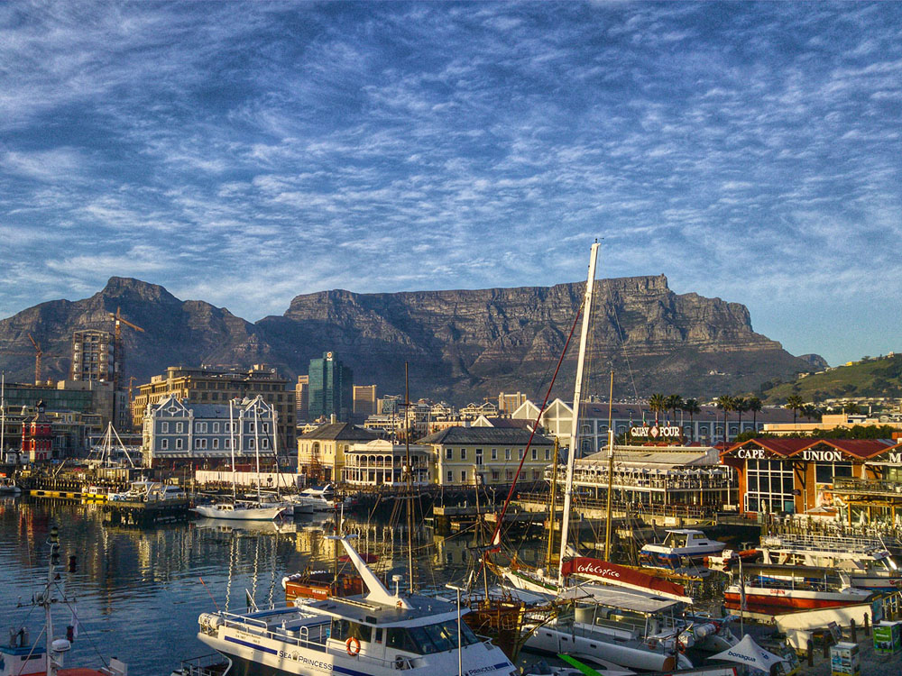 A view of Cape Town harbour from the waterfront with Table Mountain in the background.