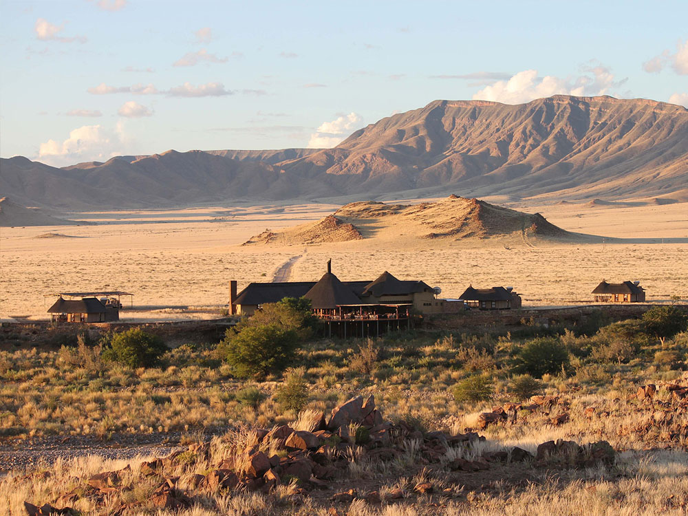 A distant view looking onto Hoodia Desert Lodge and the surrounding landscape.