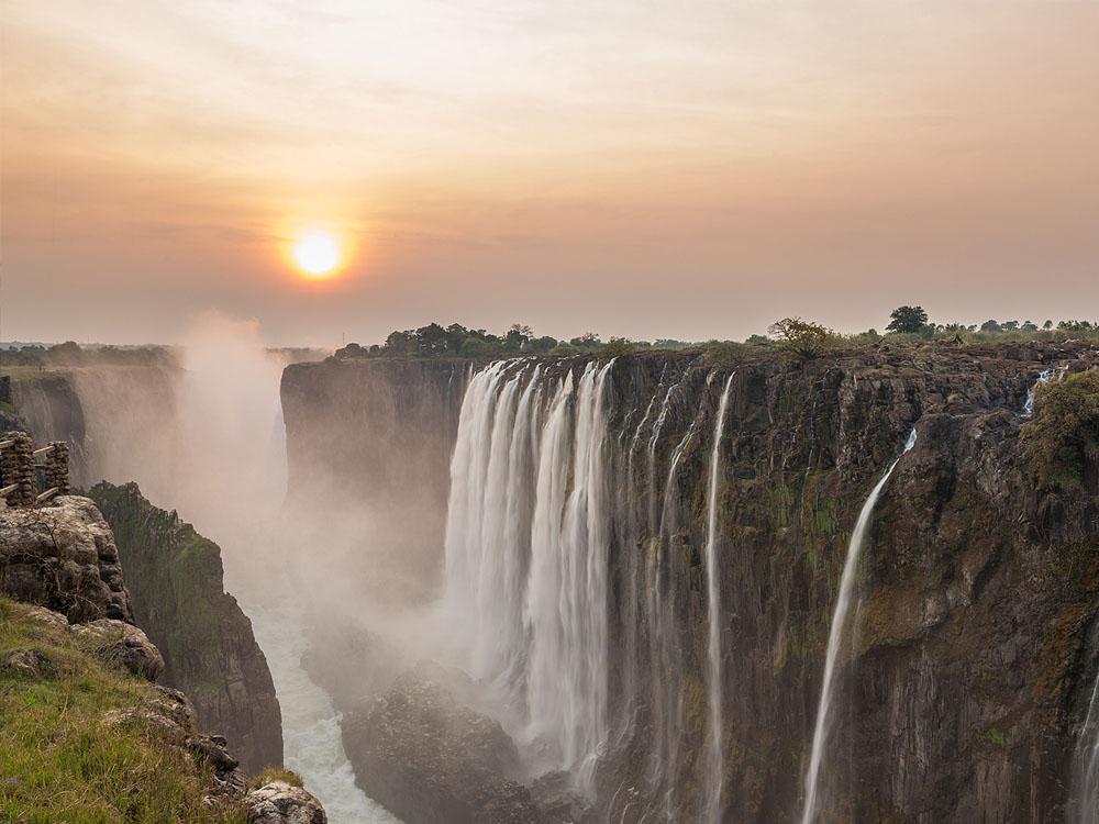 Victoria Falls and gorge at sunrise.