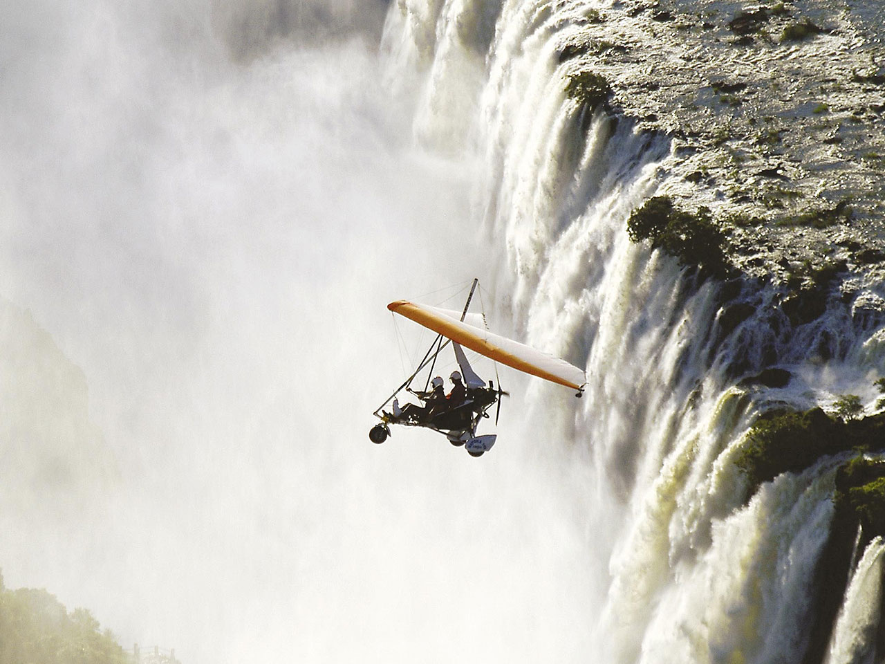 A microlight safari over the white water and spray of Victoria Falls.