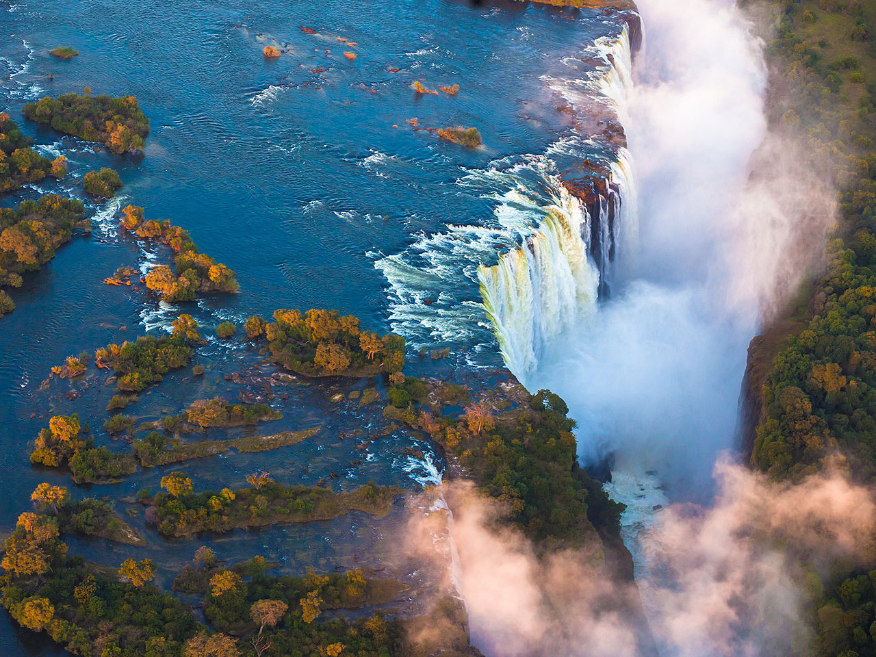 Victoria Falls and the mist coming from the gorge taken from above.