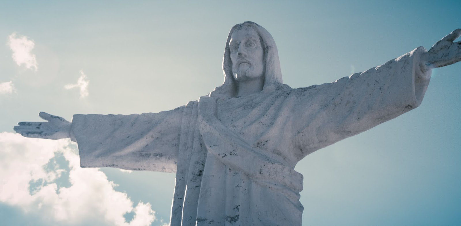 A statue of Christ against the evening sky