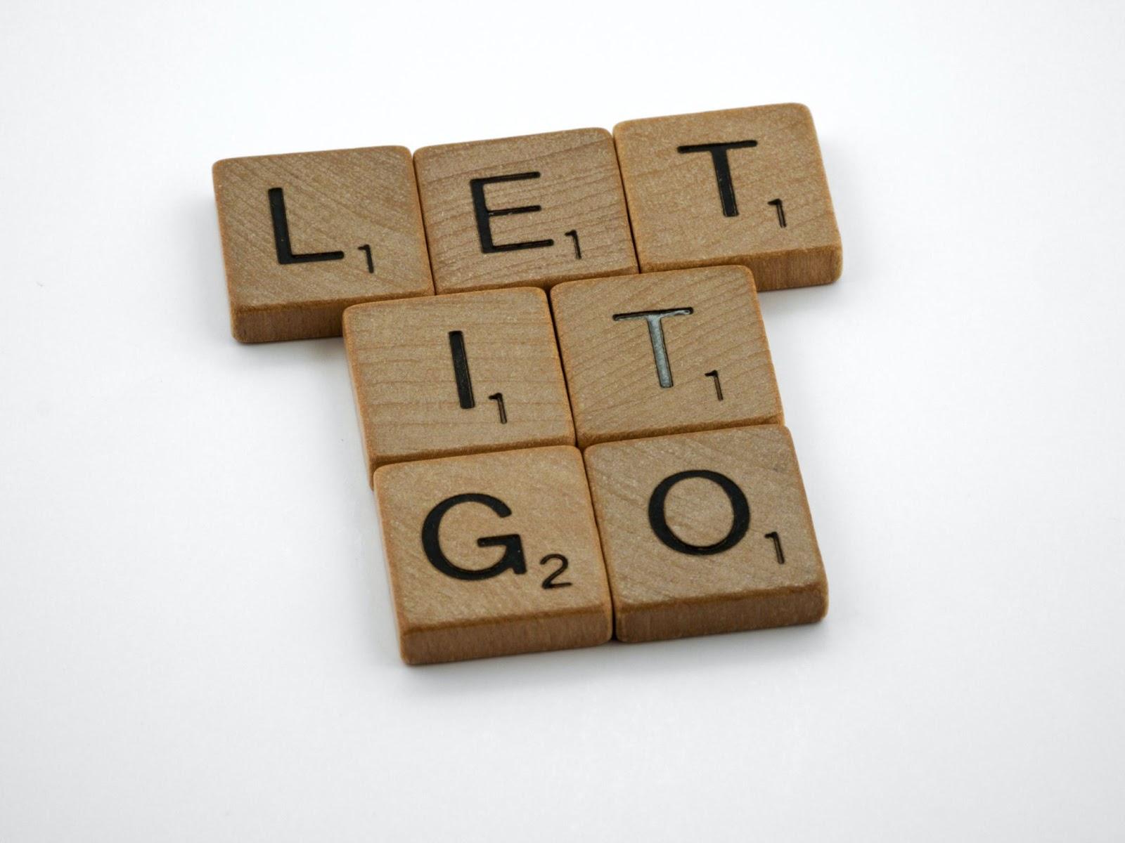 Scrabble pieces spelling out Let It Go