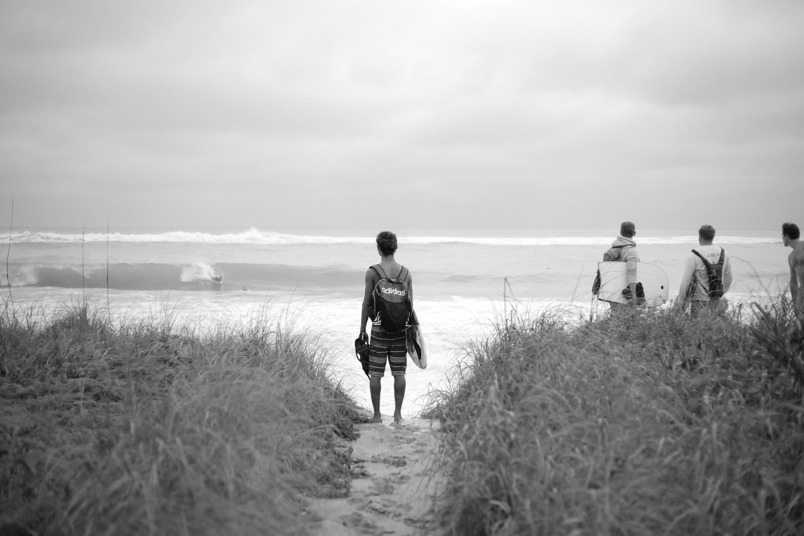 a surfer looking out at the waves in the ocean