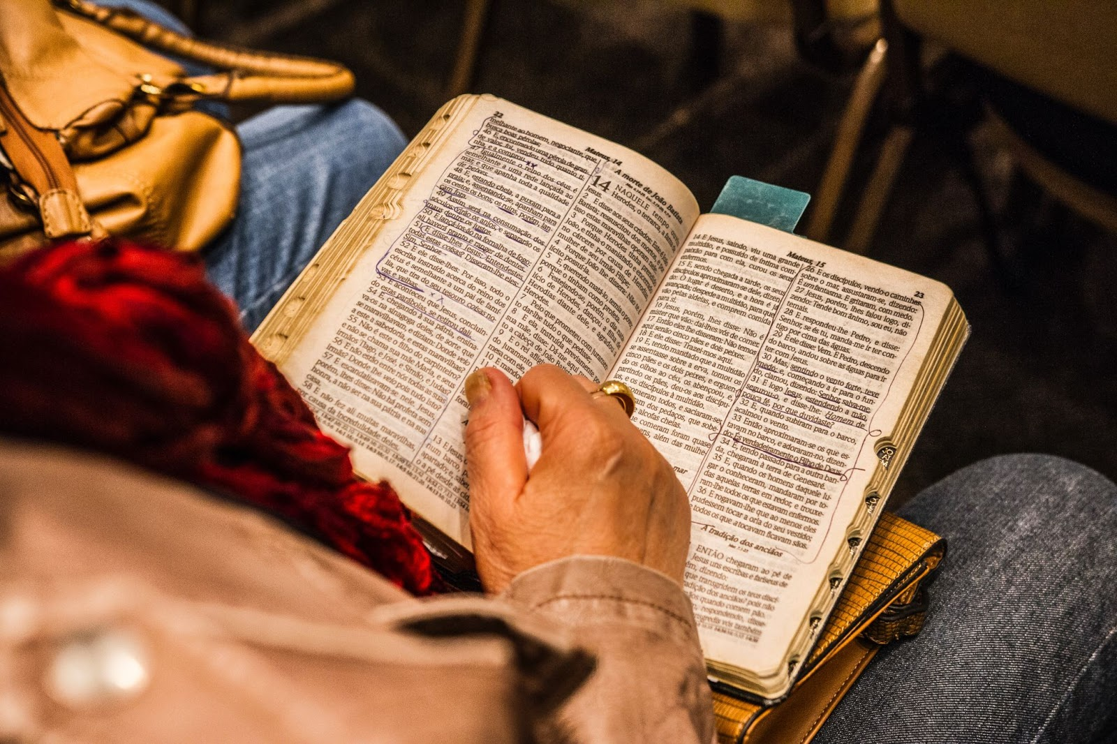 Person reading scriptures that are marked up.