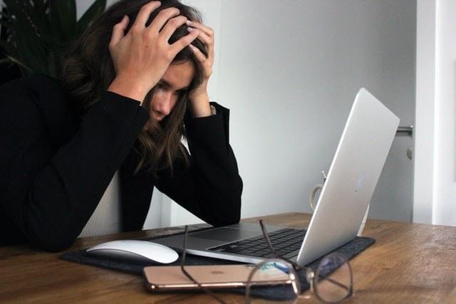 Businesswoman stressed at work
