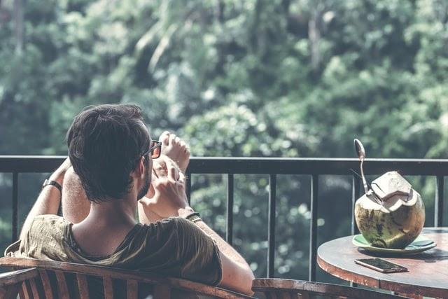 Man relaxing on balcony