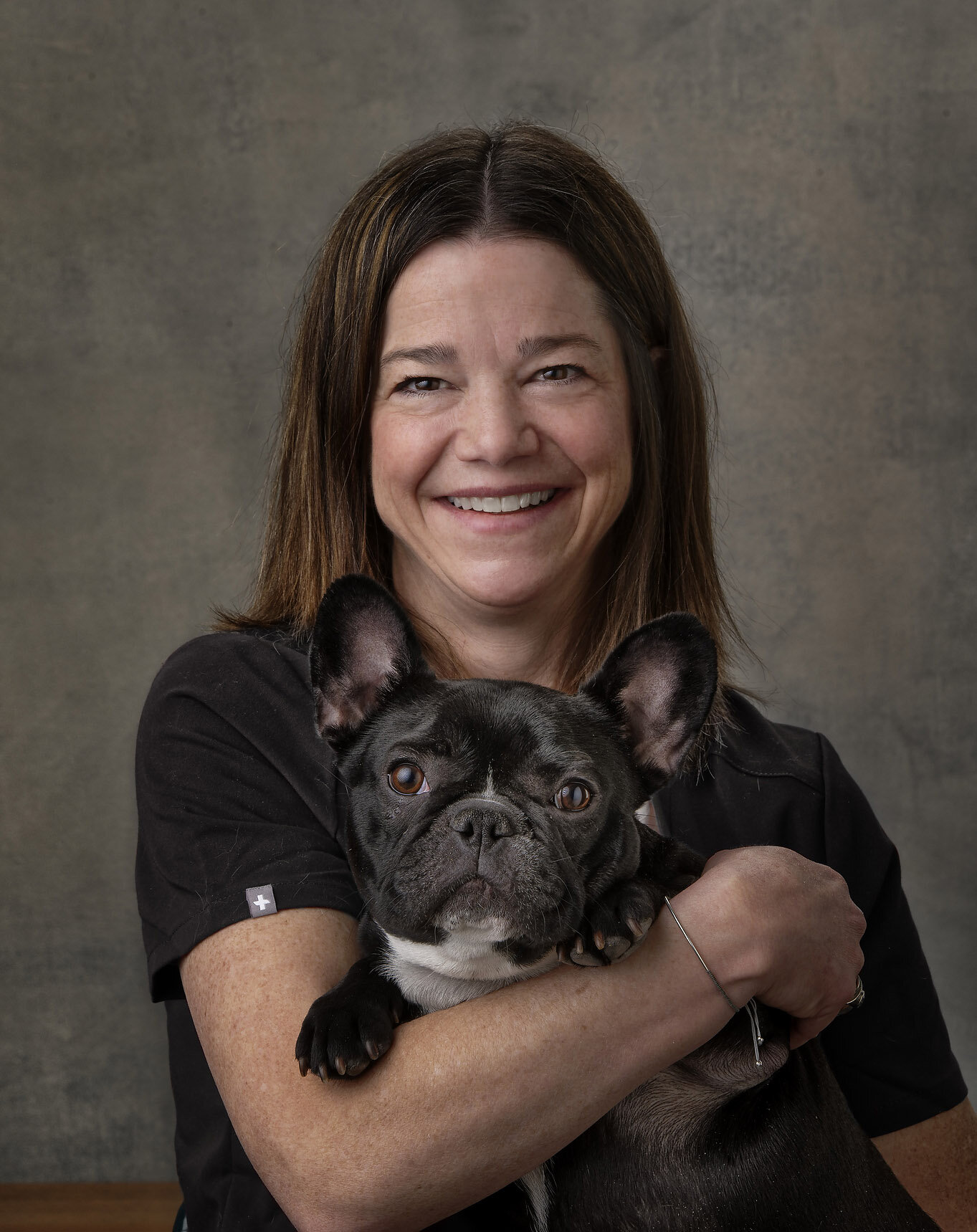 Portrait photo of Dr. Becky Valentine with her dog.
