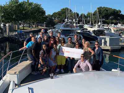 team outing on a boat photo